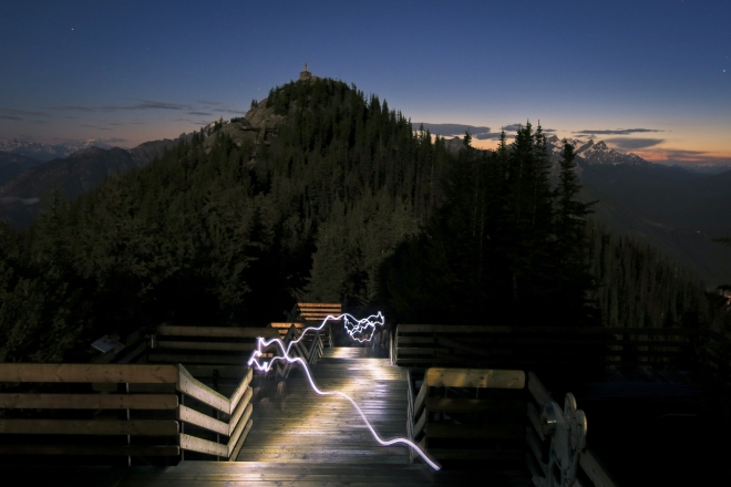 Night running along the top of Banff's local Sulphur Mountain, during spring 2013 flood/blackout