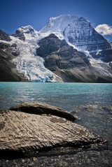 Berg Lake and the Rockies' tallest mountain, Mount Robson (3954m), towering two vertical kilometres over the tarn.