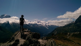 Trail-runner glory shot atop Aiguillette des Posettes (2201m). Mont Blanc and Chamonix in the background.